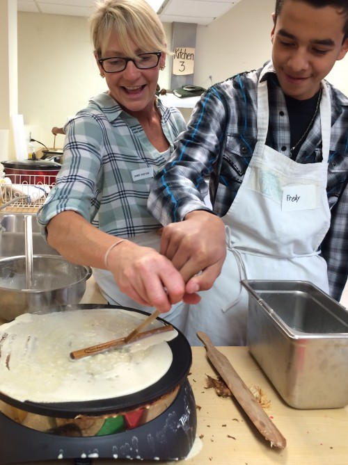 Crepe-making is an art that requires practice and a light touch with the trowel spreader.