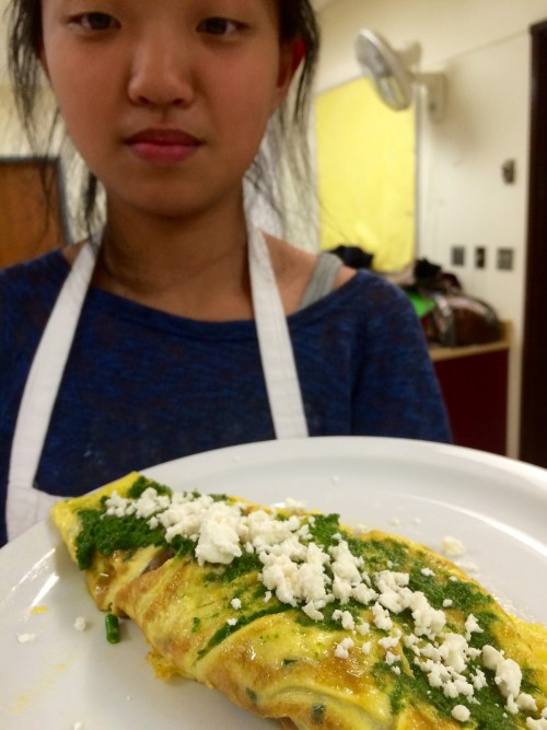 The finished frittata, garnished with fresh crumbled feta.