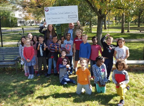 Kirsten Cluver, an associate chemist at Church & Dwight, Co., Inc., presented the Princeton School Gardens Cooperative an $8,000 check from the company's Employee Giving Fund. The funds will be distributed equally among the PTO boards of the four elementary schools to be used for edible garden education during the 2015-2016 school year. The Church & Dwight Employee Giving Fund is a workplace giving fund which was established in 2005 to meet the desires of employees to actively support and participate in the good works of not-for-profit organizations. For more information on the fund, click on the photo.